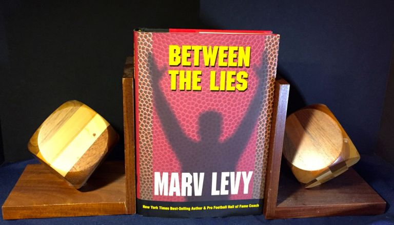 BETWEEN THE LIES. Marv Levy.
