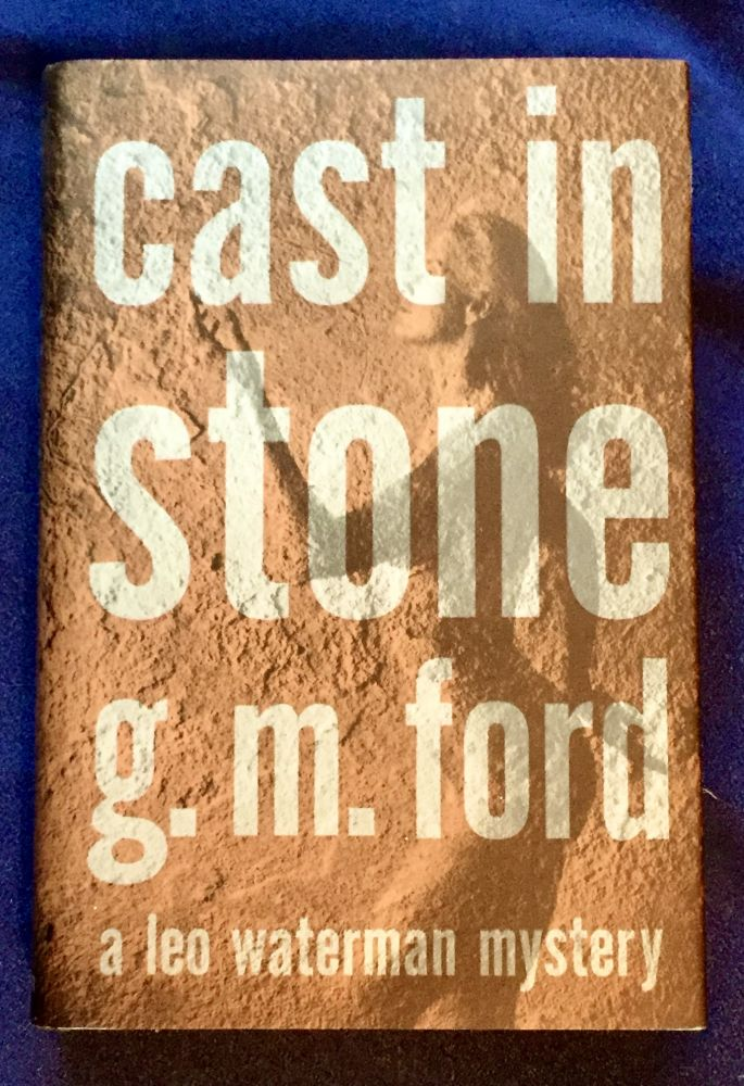 CAST IN STONE; A Leo Waterman Mystery / G. M. Ford. G. M. Ford.