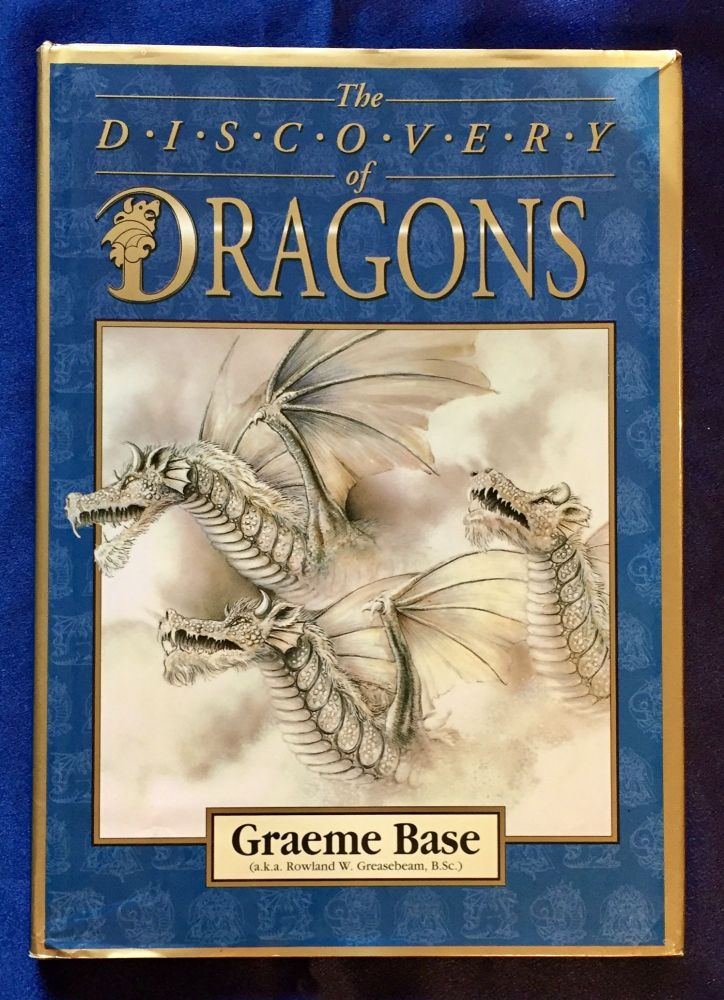 THE DISCOVERY OF DRAGONS; Graeme Base / For All the Dragons in My Life. Graeme Base.