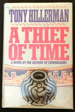 A THIEF OF TIME; A Novel. Tony Hillerman.